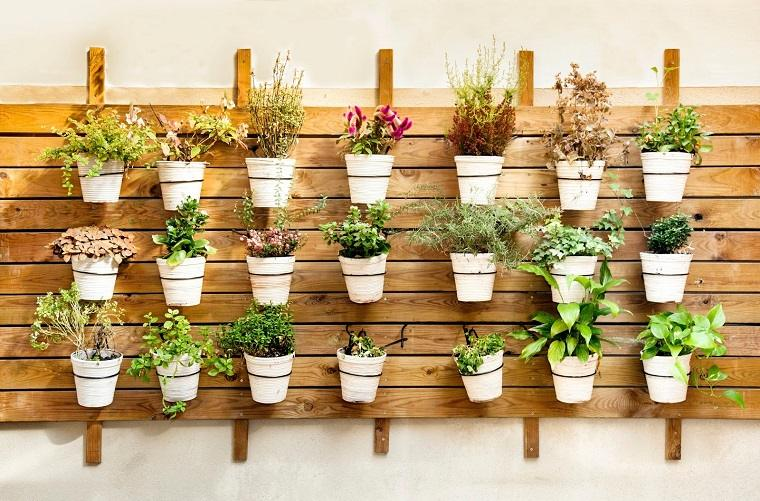opciones decorar jardin patio pared macetas ideas