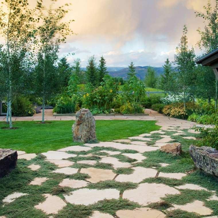 Suelos senderos y caminos de jard n en 48 im genes for Camino con piedras para el jardin