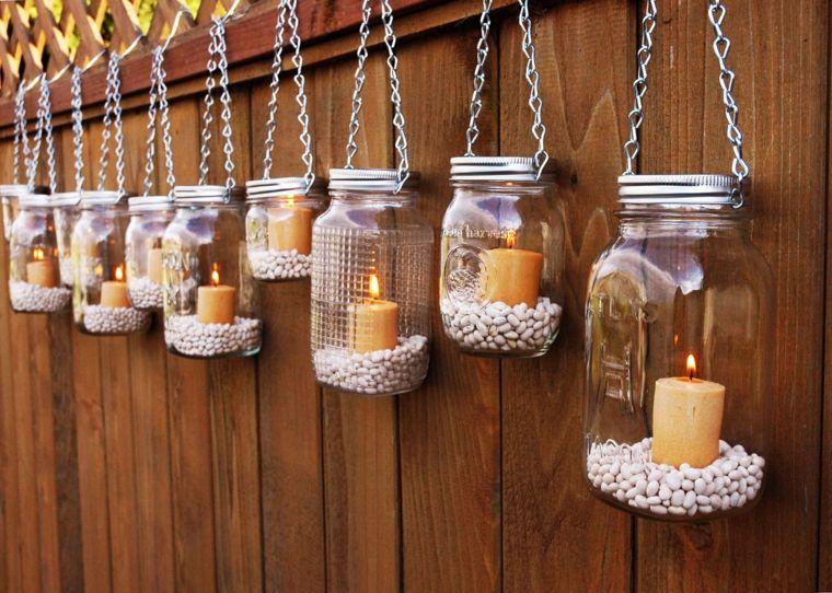 velas decorativas colgando valla
