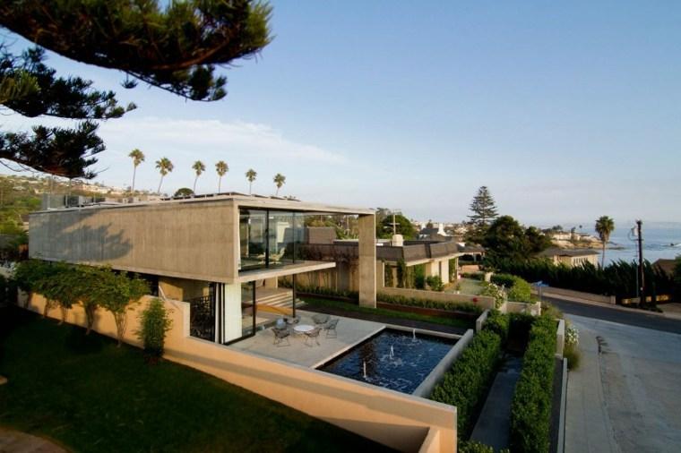 casa moderna estanque fuentes decoracion jardin moderno ideas