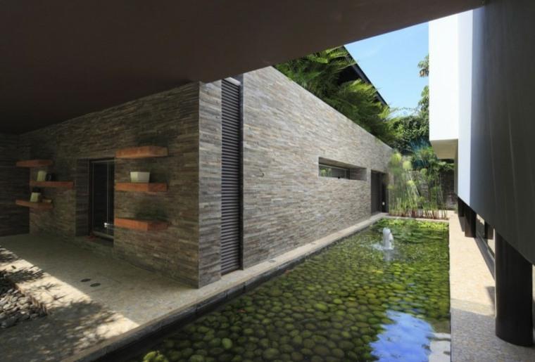 estanque piedras jardin estrecho casa moderna ideas