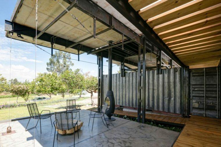 diseño porche jardin chimenea moderna