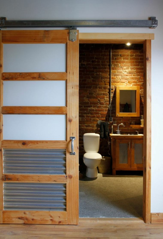 Puerta corredera de madera para el interior for Puerta industrial