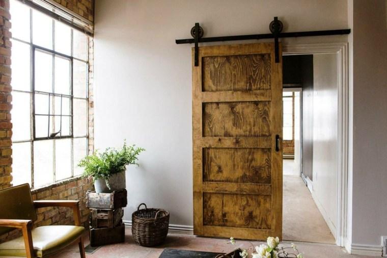 Puerta corredera de madera para el interior for Como hacer herrajes rusticos