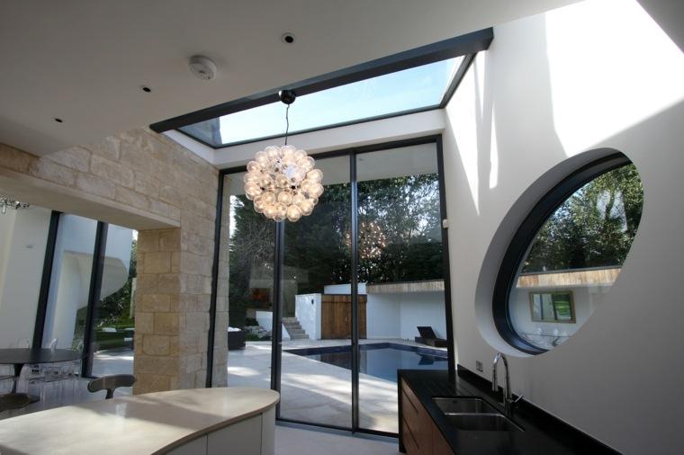 Casas de cristal para interiores luminosos -