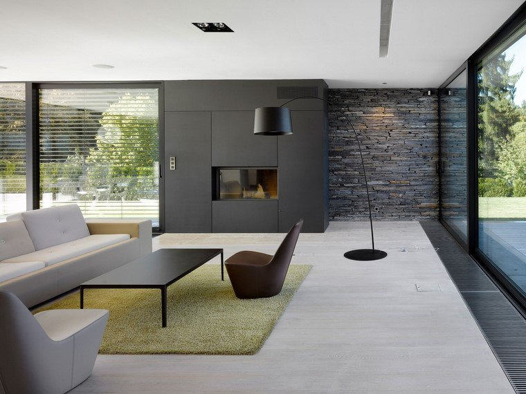 Decoraci n interiores minimalistas con paredes de piedra for Stili di interior design