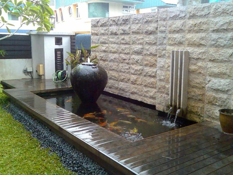 Peces de agua dulce koi para criar en el jard n moderno for Fuentes con peces