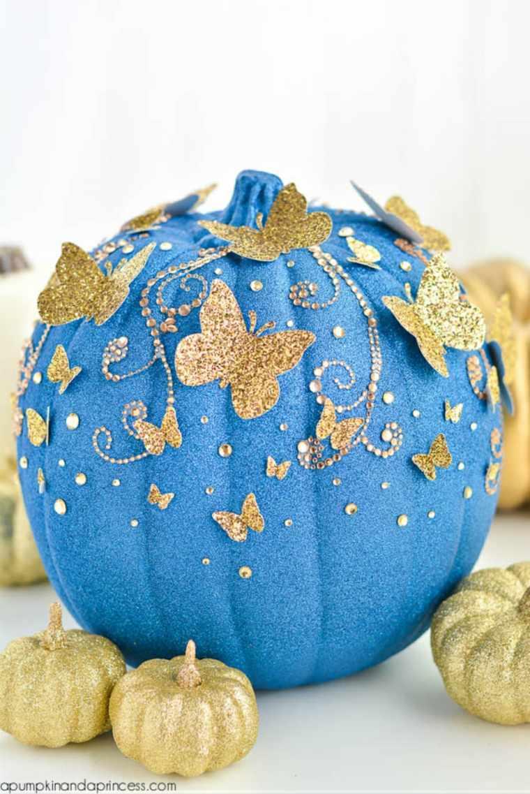 calabaza color azul mariposas doradas