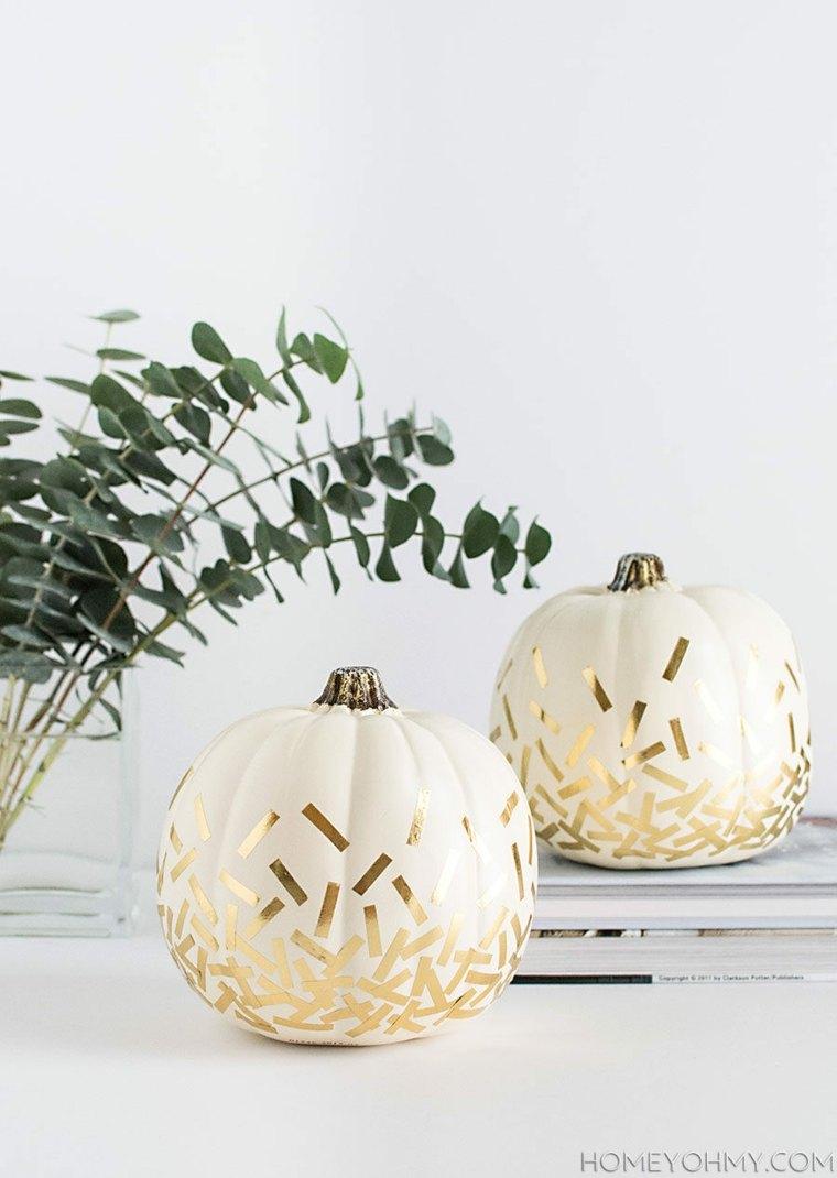 originales calabazas decoradas tiras doradas