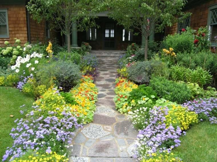sendero jardin piedra grandes flores entrada ideas
