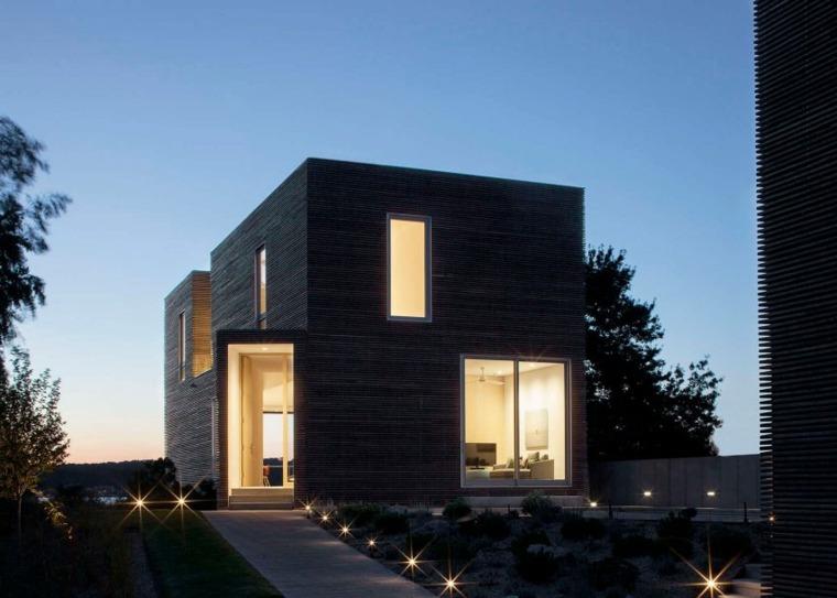 Fachadas de casas de madera quemada for Archi in casa moderna
