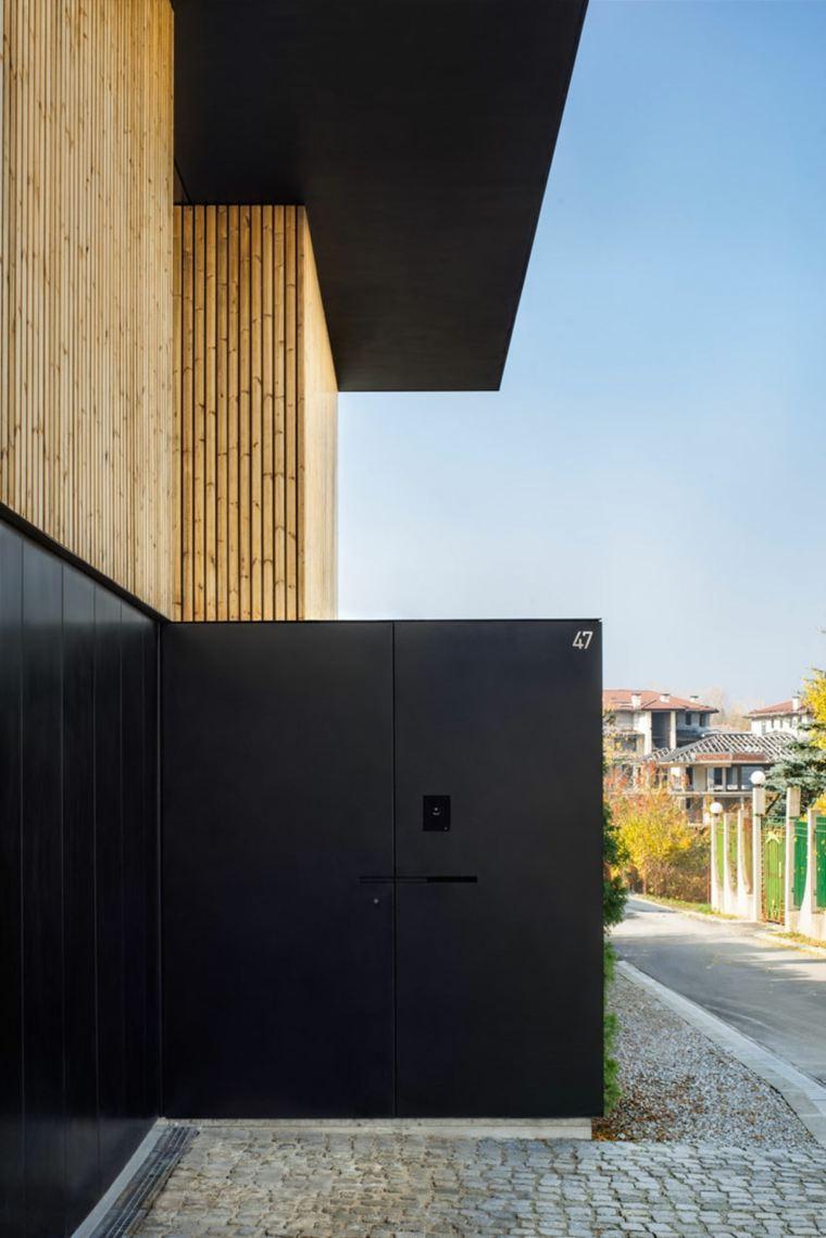 fachada moderna negro madera