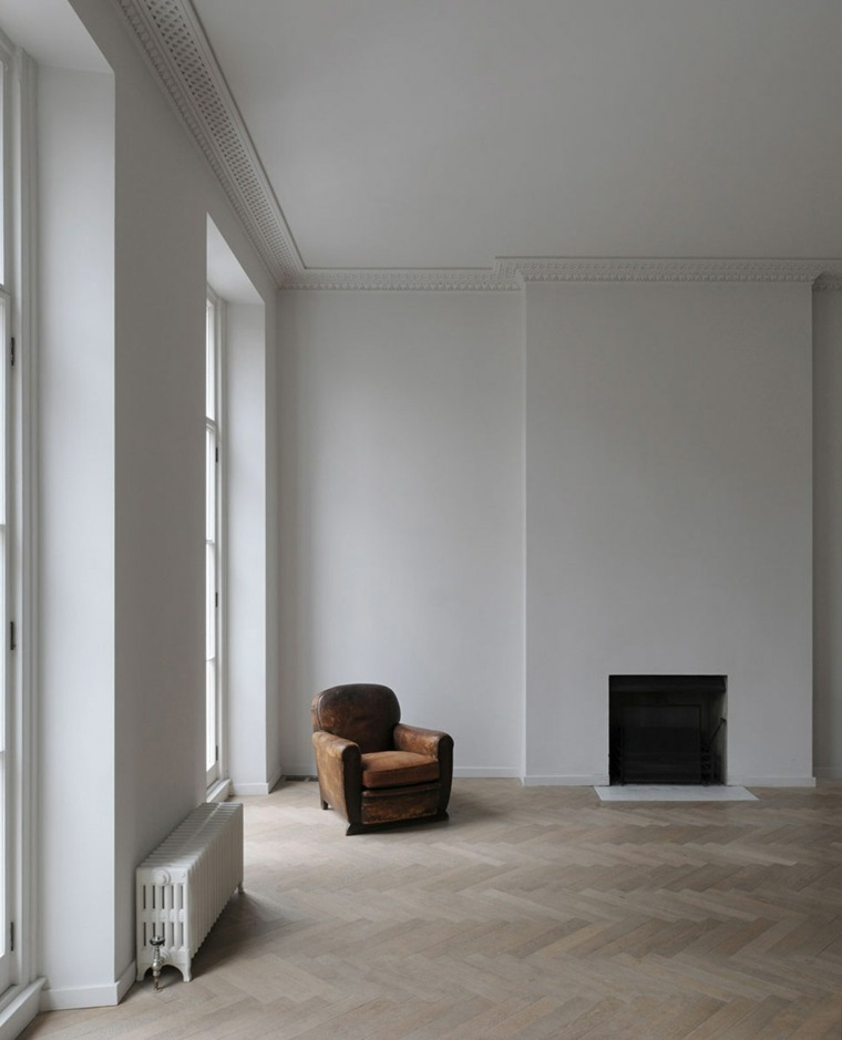 sala estar sillón chimenea