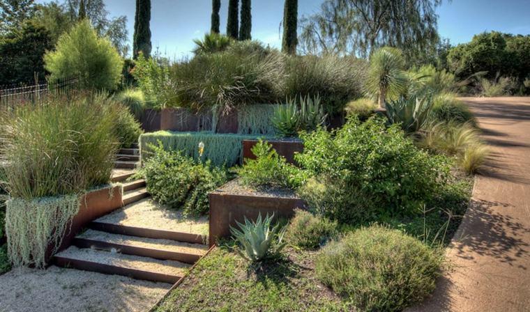 bonito jardín terrazas cascadas