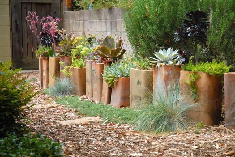 originales plantadores camino jardín