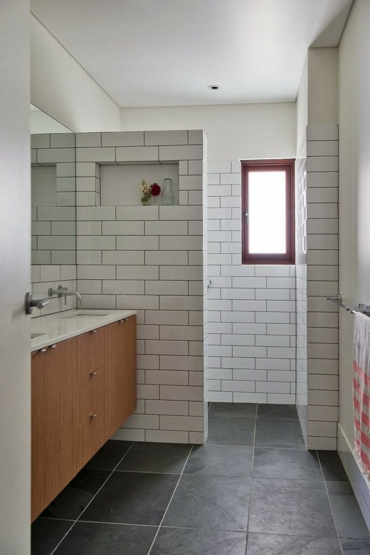 Azulejos blancos de estilo metro en ba os y cocinas for Diseno cocinas y banos
