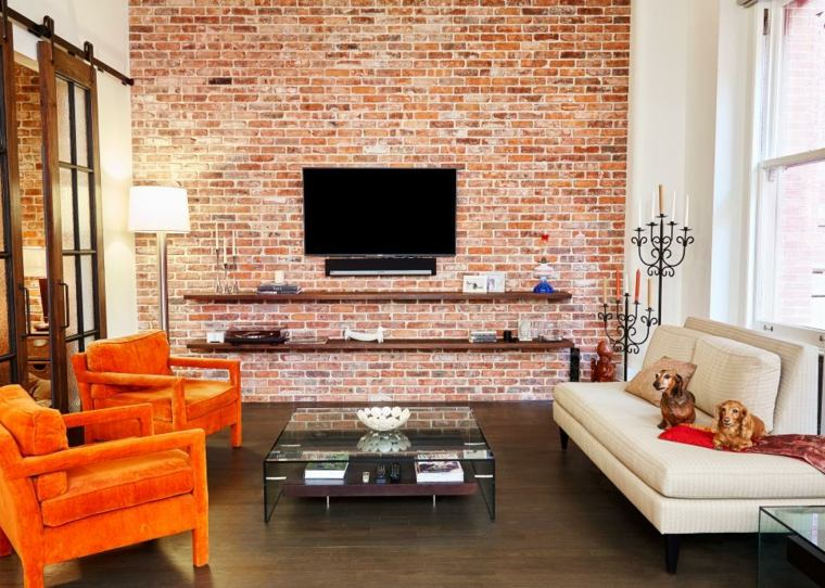 decorar salones acogedores loft ladrillos pared naranja