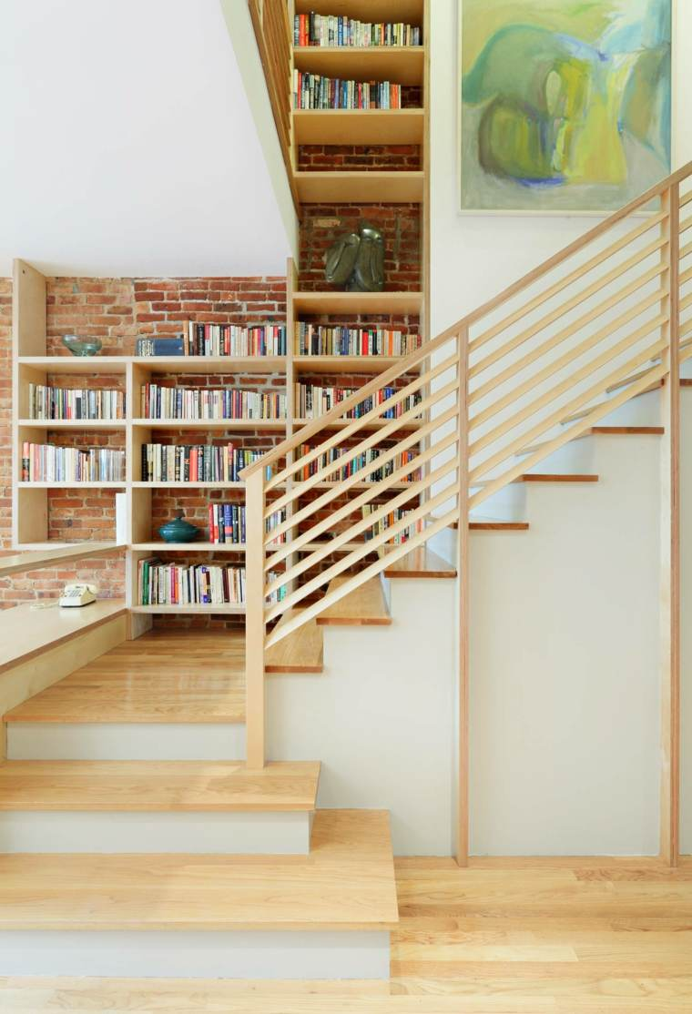 escaleras de interior diseno libreria pared ladrillo NC2 Architecture ideas