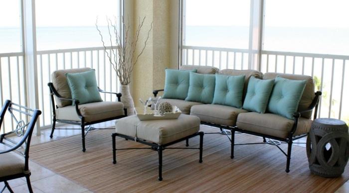 balcon diseño saofas acentos alfombras mesas