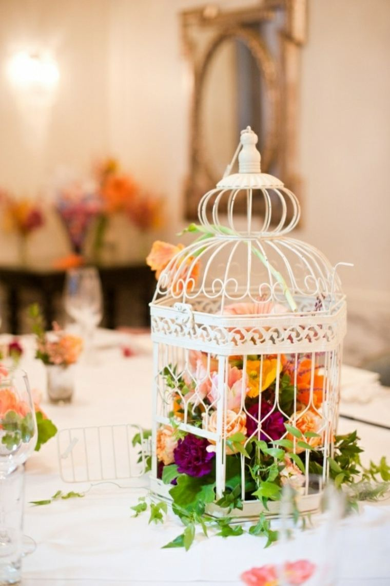 decorar mesa jaula flores