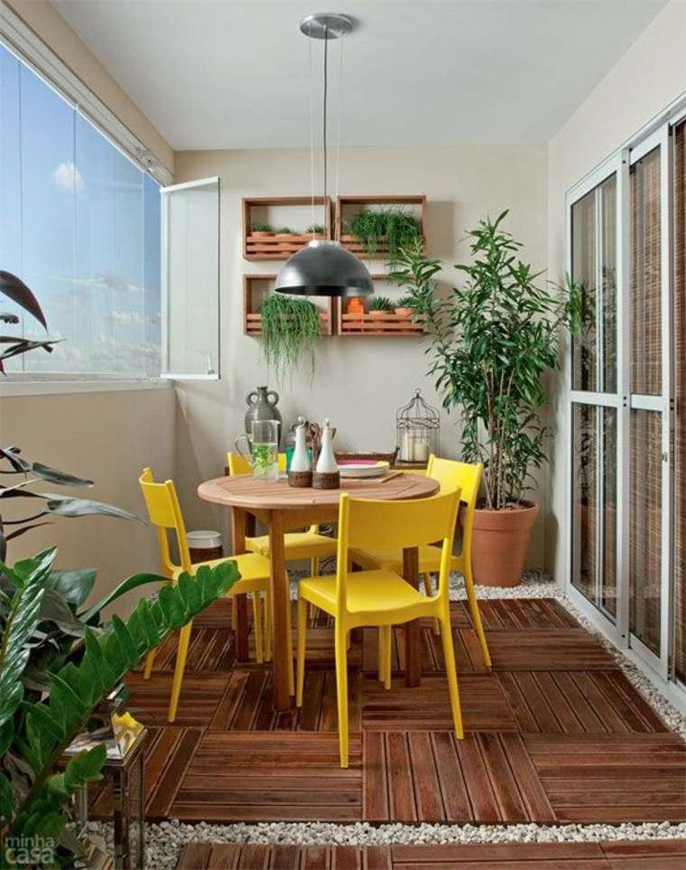 conjunto mesa sillas amarillas balcón