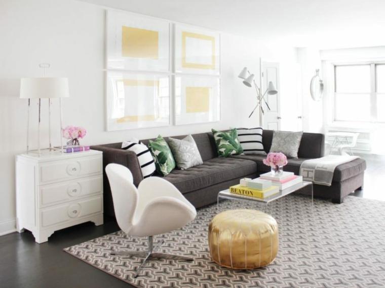 cuadros paredes sobres sofa dorados