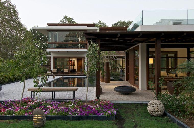 decorar terrazas barato banco madera flores ideas