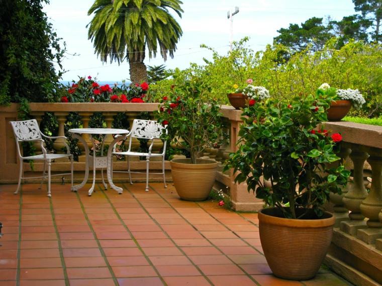 decorar terrazas barato macetas flores terraza ideas