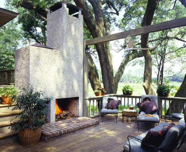 decorar jardin chimenea exterior terraza suelo madera ideas