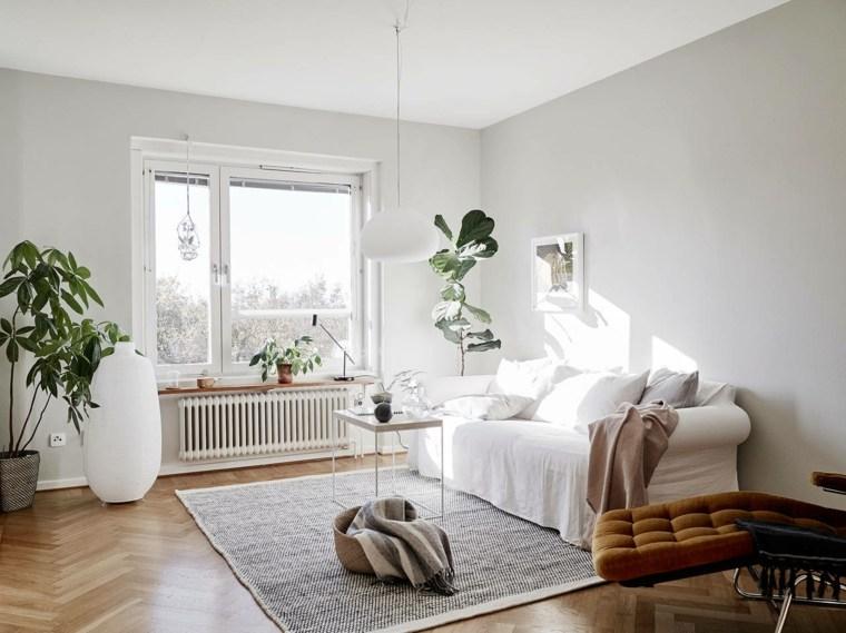 salones-de-diseno-estilo-nordico-plantas-sofa-blanca