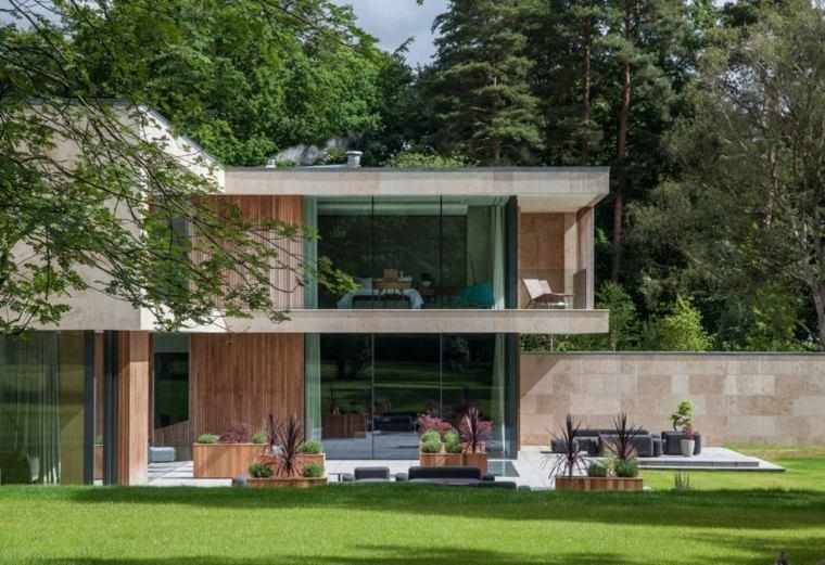 vallas metalicas madera hormigon piedra casa valla alta piedras Lewandowski Architects ideas