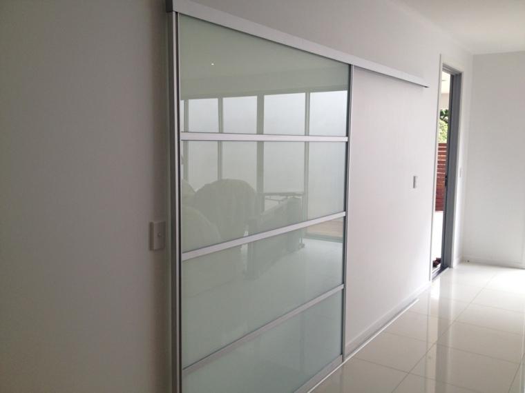 Puertas correderas de cristal para interiores con clase for Puertas correderas de cristal