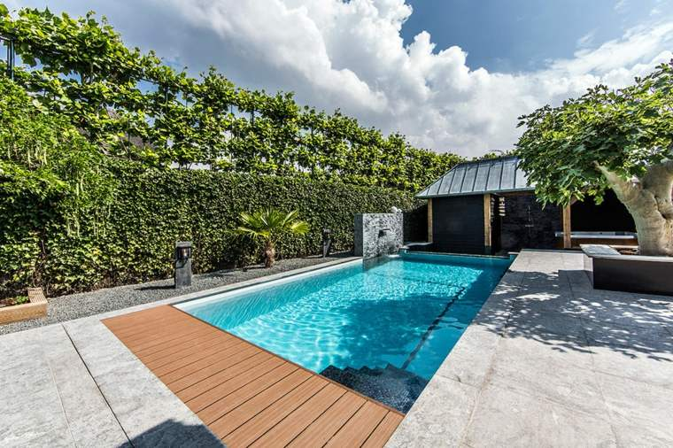 jardines-piscinas-grava-suelos-muro-verde-minimalistas