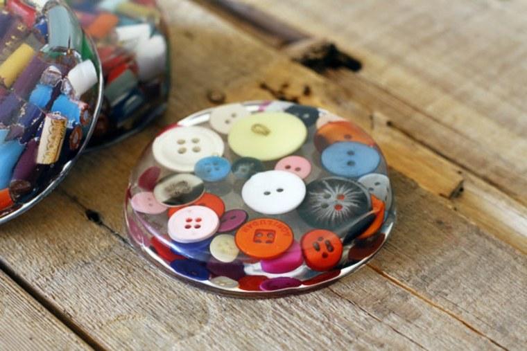 pisapapeles botones