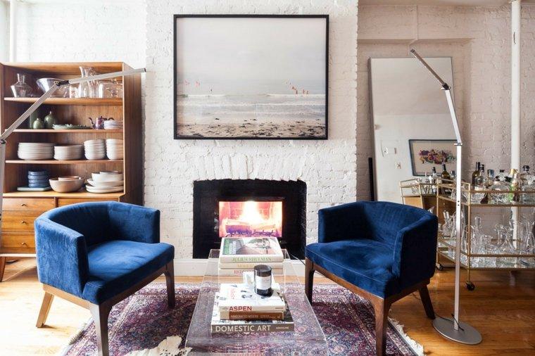 salon-chimenea-sillones-azules-cuadro-grande-decoracion