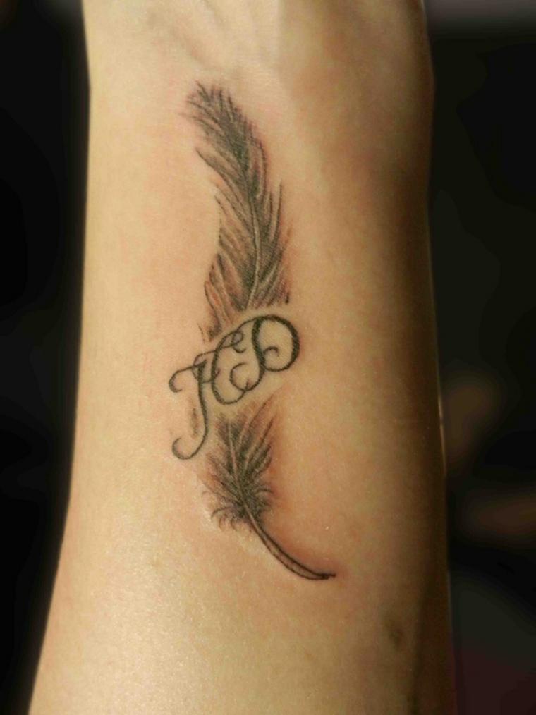 tatuajes con plumas