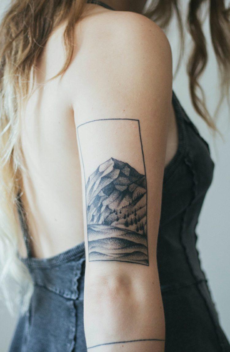 tatuajes diseño femenino montanas