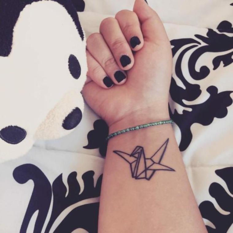 tatuaje pajarita de papel