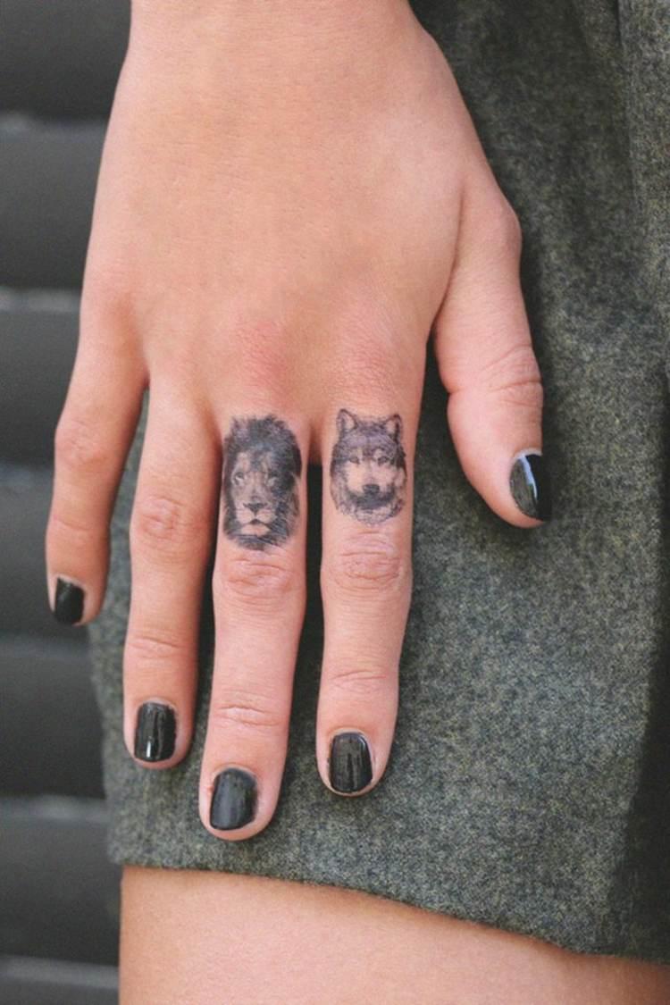 animales tatuados dedos manos