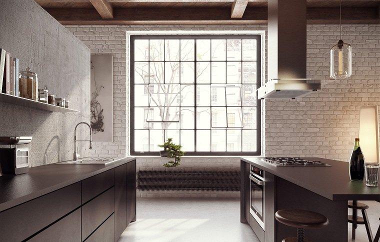 cocina-encimeras-granito-negro-isla-espacios-amplios