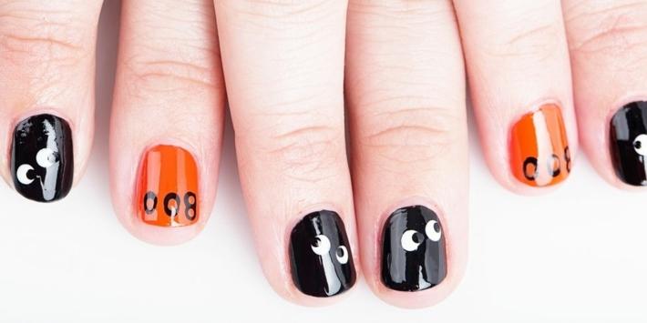 diseños de uñas negro naranja