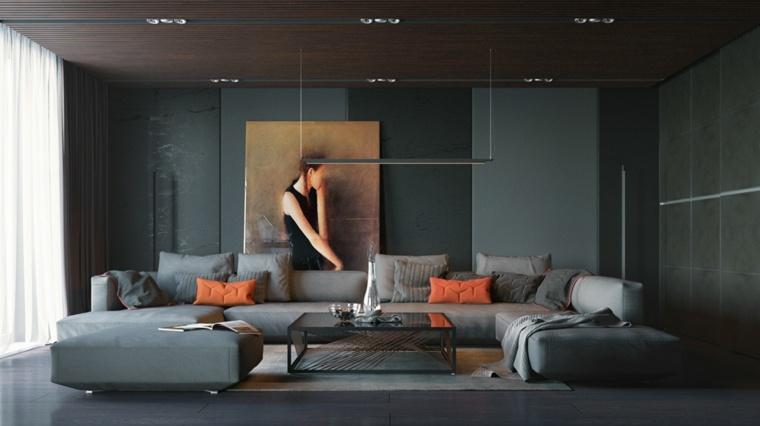 pared-negra-cojines-naranja-destacan-salon-amplio