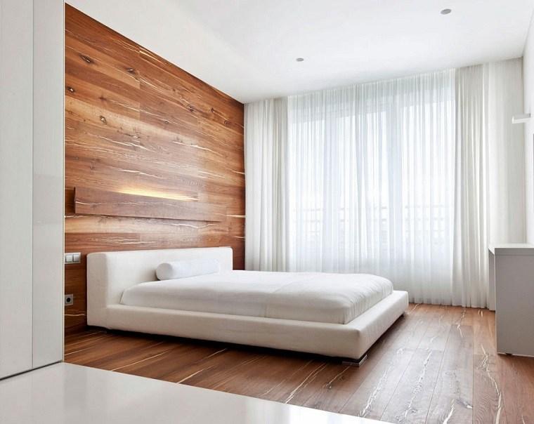 bonito dormitorio con pared de madera