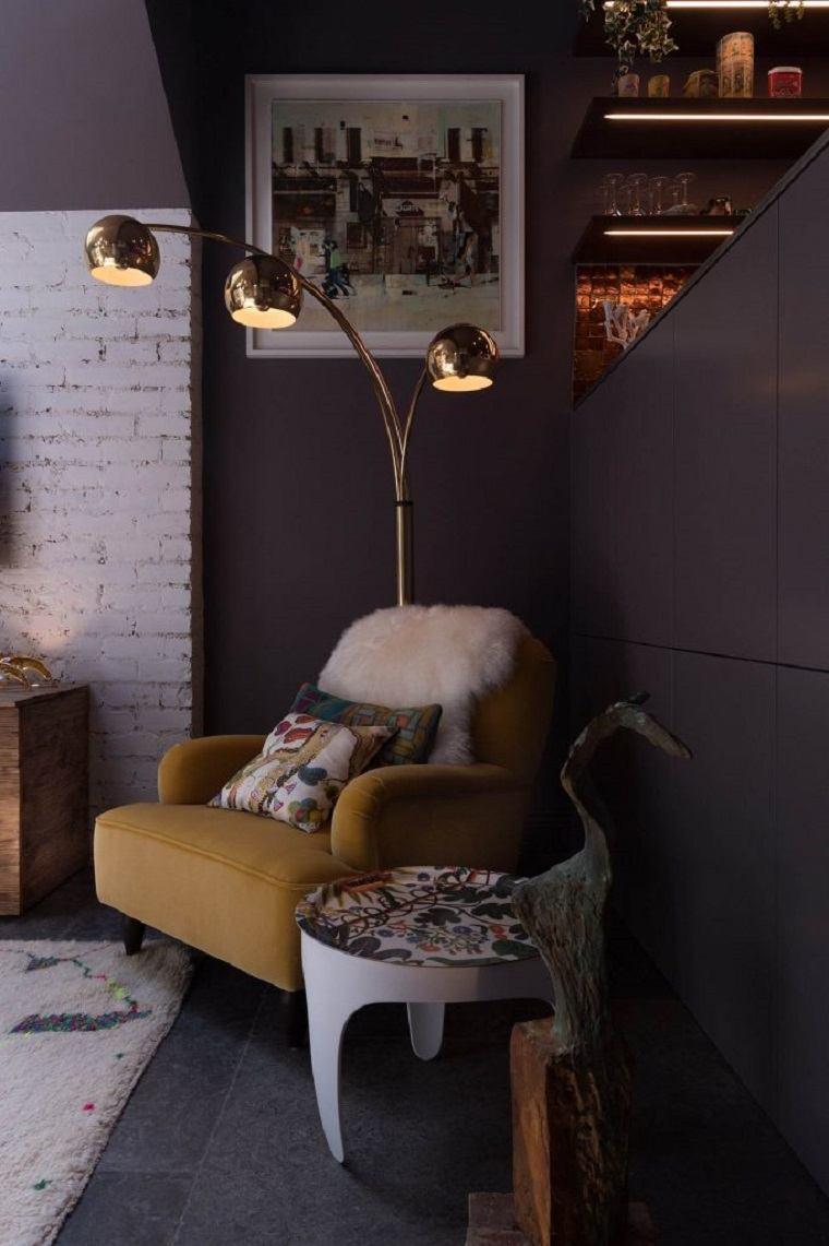 acentos faroles dorados sillon