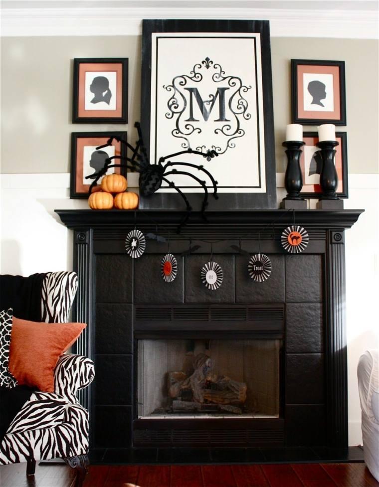 decorar chimeneas negra-con-cuadros