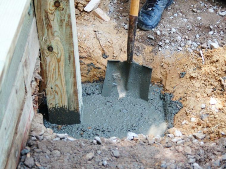 fijar con concreto