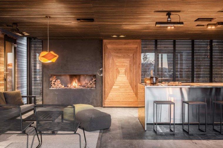 casas en noruega-isla-salon-cocina-chimenea-pared