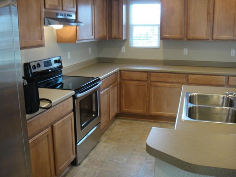 Encimeras de cocina tipos de materiales y consejos for Mejor material para encimeras de cocina