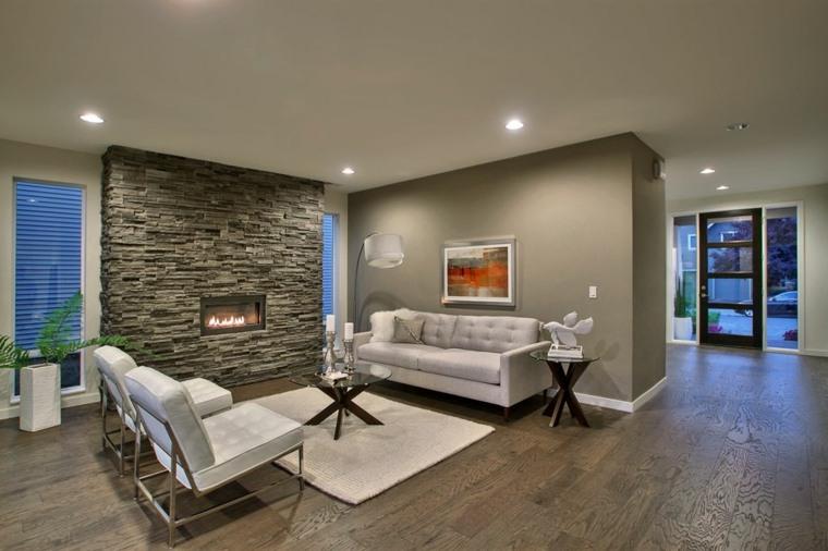 salón con pared de acento de piedra gris