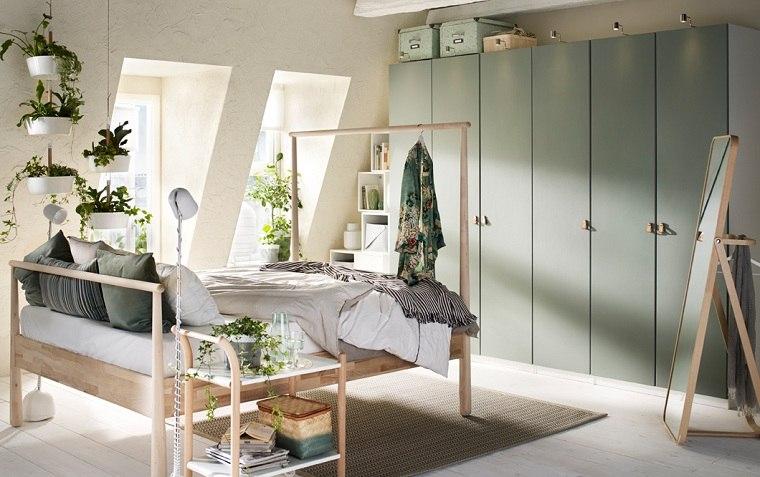 armario-grande-color-verde-claro-cama-madera